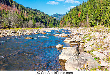 wild mountain river with rocky shore. lovely autumn scenery...