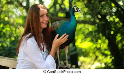 wild park with  girl and peacock.