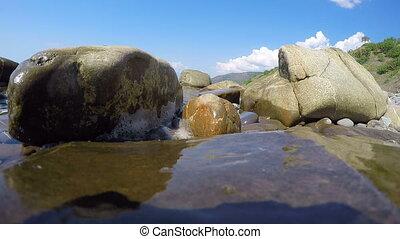 Wild pebble beach sea shore of Crimea low angle view