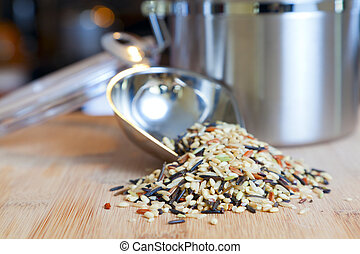 Image of an open jar with wild rice on a cutting board