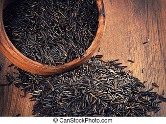 wild rice in a wooden bowl