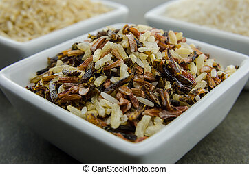 Wild Rice in Foreground - Wild rice in a ceramic bowl in the...