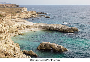 Wild rocky beach on the Black Sea in Crimea
