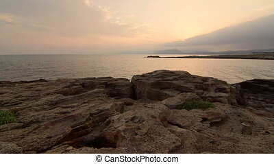 Wild rocky beaches of Cape Meganom in the evening