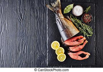 wild salmon cut in steaks on a tray