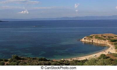 Wild sandy beach in the beautiful bay of Aegean Sea.