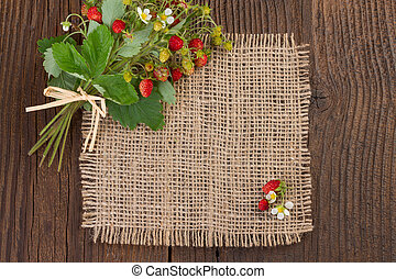 wild strawberries on rustic background