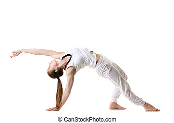 Wild Thing yoga pose - Young fitness model in white...