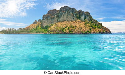 Wild tropical island with coral reef around