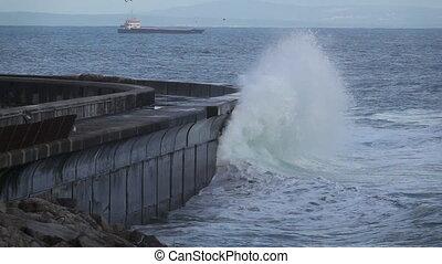 Wild waves breaking in the atlantic coast breakwater