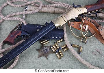 Wild west rifle, ammunition and sheriff badge