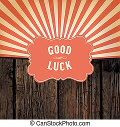 """Wild west styled """"Good Luck"""" message on wooden board. With red rays background"""