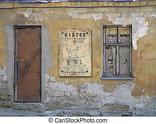 Wild West styled poster. The thrown old house. The window and a door are closed. A shabby structure.