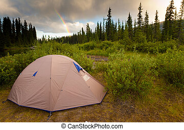 Wilderness Camping Concept - Tent at the end of the rainbow...