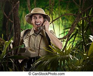 Wilderness communications - Young retro explorer having a...