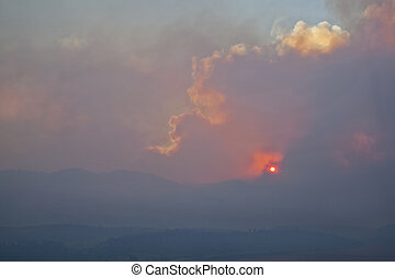 wildfire smoke over Rocky Mountains