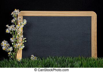 wildflower bouquet on black chalkboard