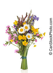 Wildflower and grass varieties tied in a bunch isolated over white background.