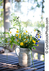 Bouquet of wildflowers on table
