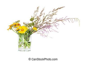 Wildflowers in a glass beaker
