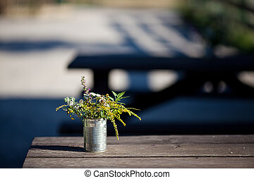 wildflowers in a tin on the table
