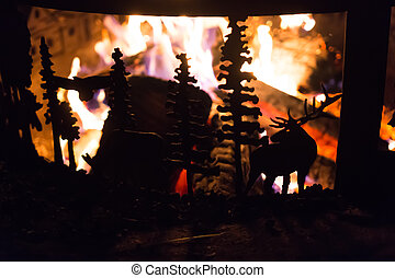 Wildlife scene on campfire metal ring