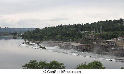 Willamette Falls in Oregon City with Hydro Electric Generator Facility and Paper Mills Panning 1920x1080