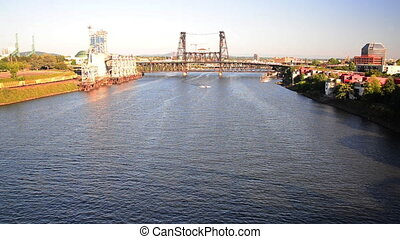 Willamette River in downtown Portland, Oregon with a boat passing under the Steel Bridge