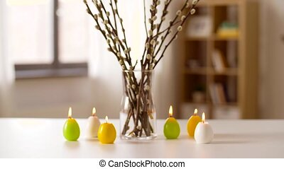 willow and candles in shape of easter eggs at home - easter,...