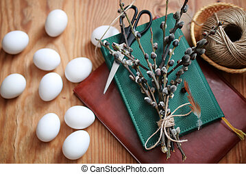 willow and egg on a wooden background