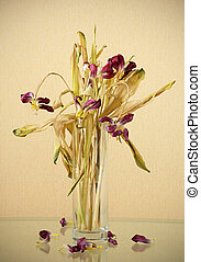 Wilted flowers - Wilted bouquet of tulips on a glass table