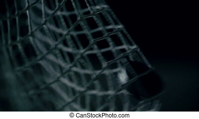 Win-Lose Game - Macro shot of puck flying into gates in slow...