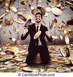 Win money - Businessman exults under a rain of money