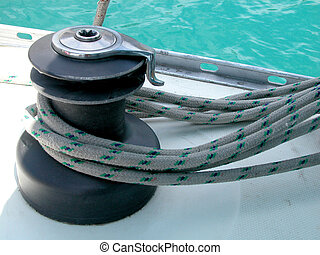 Winch and rope - Yacht winch detail, sea in the background