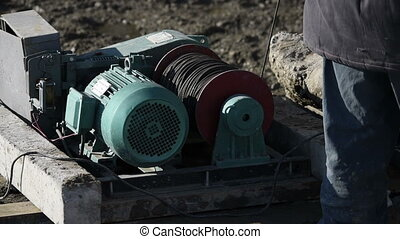 winch at a construction site - construction machinery at a...