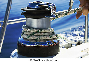 A photo of a wet rope on a boat winch being pulled in