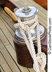Close-up of a winch on a wooden sailboat