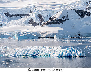 Wind and water sculpted iceberg drifting in Andvord Bay near Neko Harbor, Antarctic Peninsula, Antarctica
