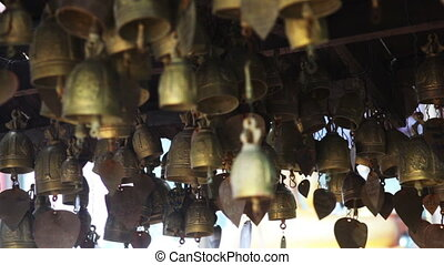 Wind Bells - Small bronse buddhist bells, that is swaying by...