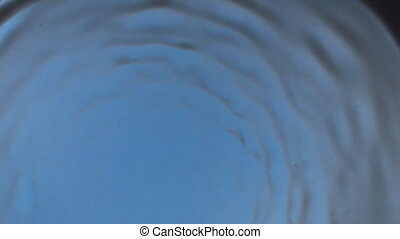 Wind blows away the black paint, creating a magical tunnel effect. Black on blue.