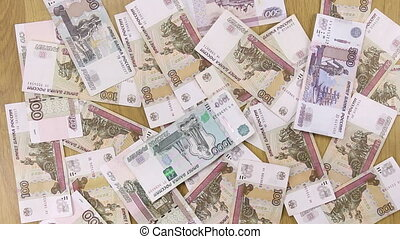 Wind blows away the rubles from the table businessman. Paper...