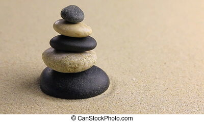 Wind blows on a pyramid made of white and black stones
