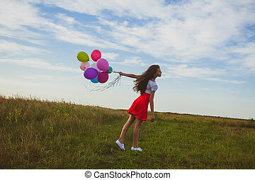 Wind blows the balloons in the hand