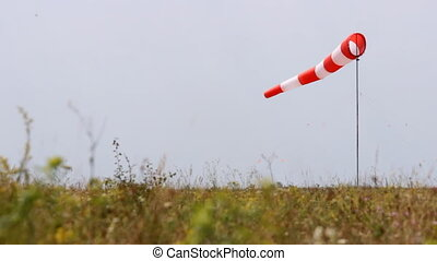 Wind Direction Indicator  flies over a take-off field