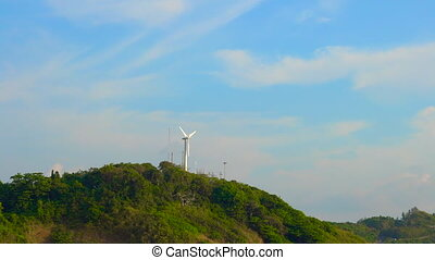 wind electric generator on top of the hill by the sea. Clean energy concept. renewable energy source