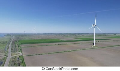 Wind electric generator - power stations in field. Aerial...