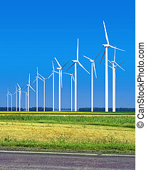 wind energy - Beautiful green meadow with Wind turbines ...