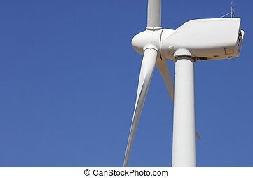 wind energy - detail of the top of a windmill with blue sky