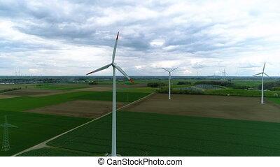 drone shot of a field full of windmills