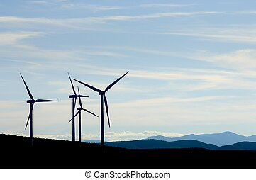 wind energy - group of windmills with cloudy sky